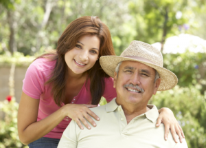 senior hispanic man with her caretaker in the garden